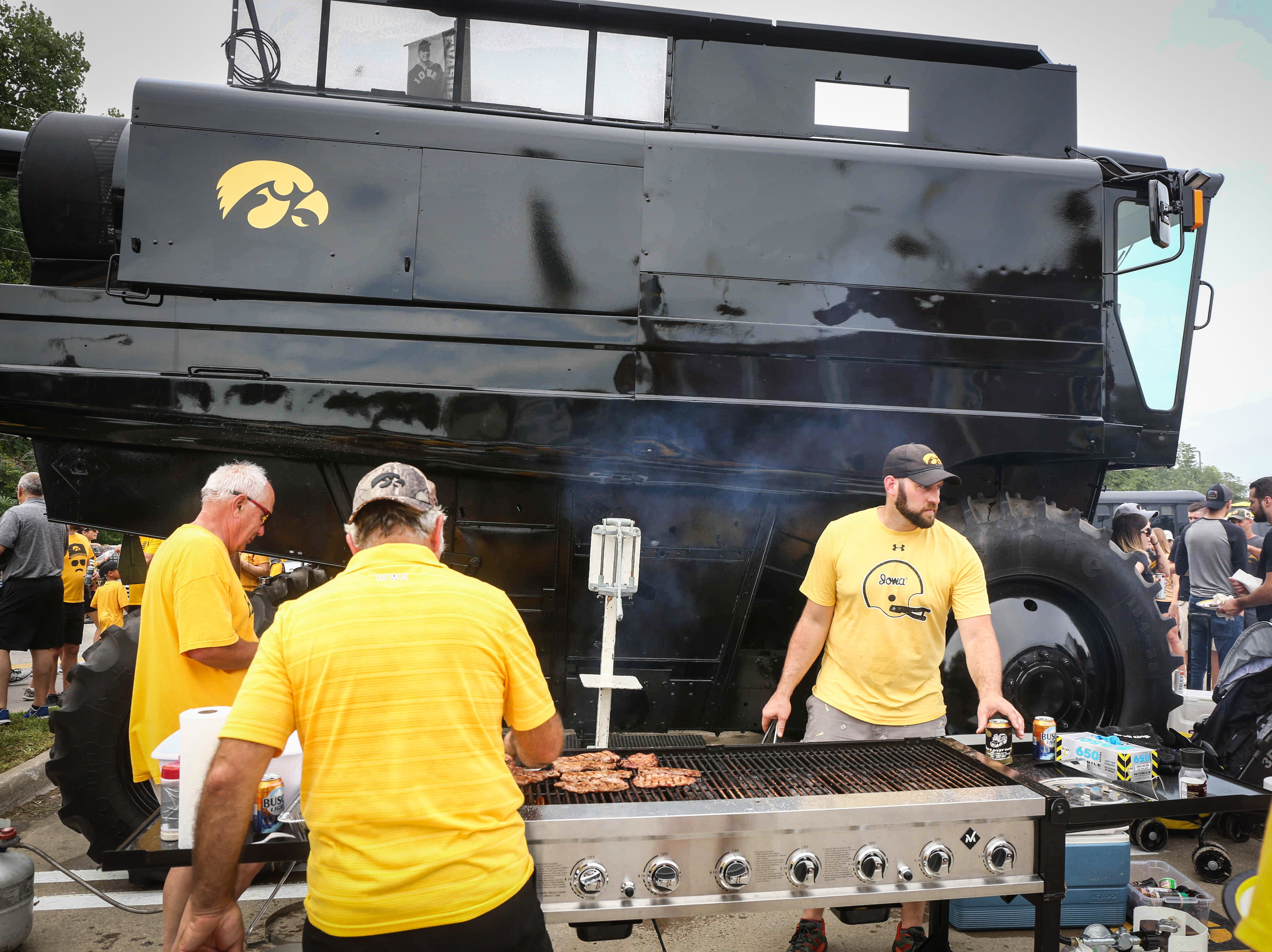 Fans gather around a combine during tailgating prior to kickoff against Northern Illinois on Saturday, Sept. 1, 2018, in Iowa City.