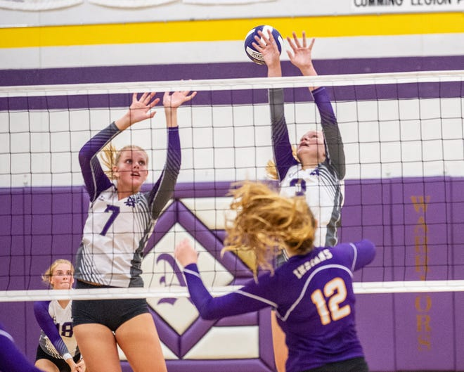 Norwalk's Jalyn Simon and Hanna Reeg reach but miss a volley by Indianola's Emma Bishop in the teams' Aug. 28 match.
