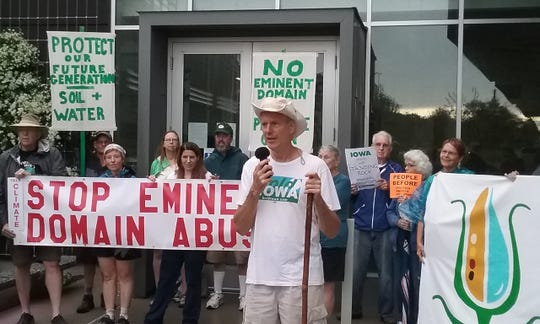 Ed Fallon, of Bold Iowa, speaks outside the Iowa Utilities Board office prior to the beginning of the First Nation-Farmer  Climate Unity March. The march route will stretch nearly 100 miles across 8 days.