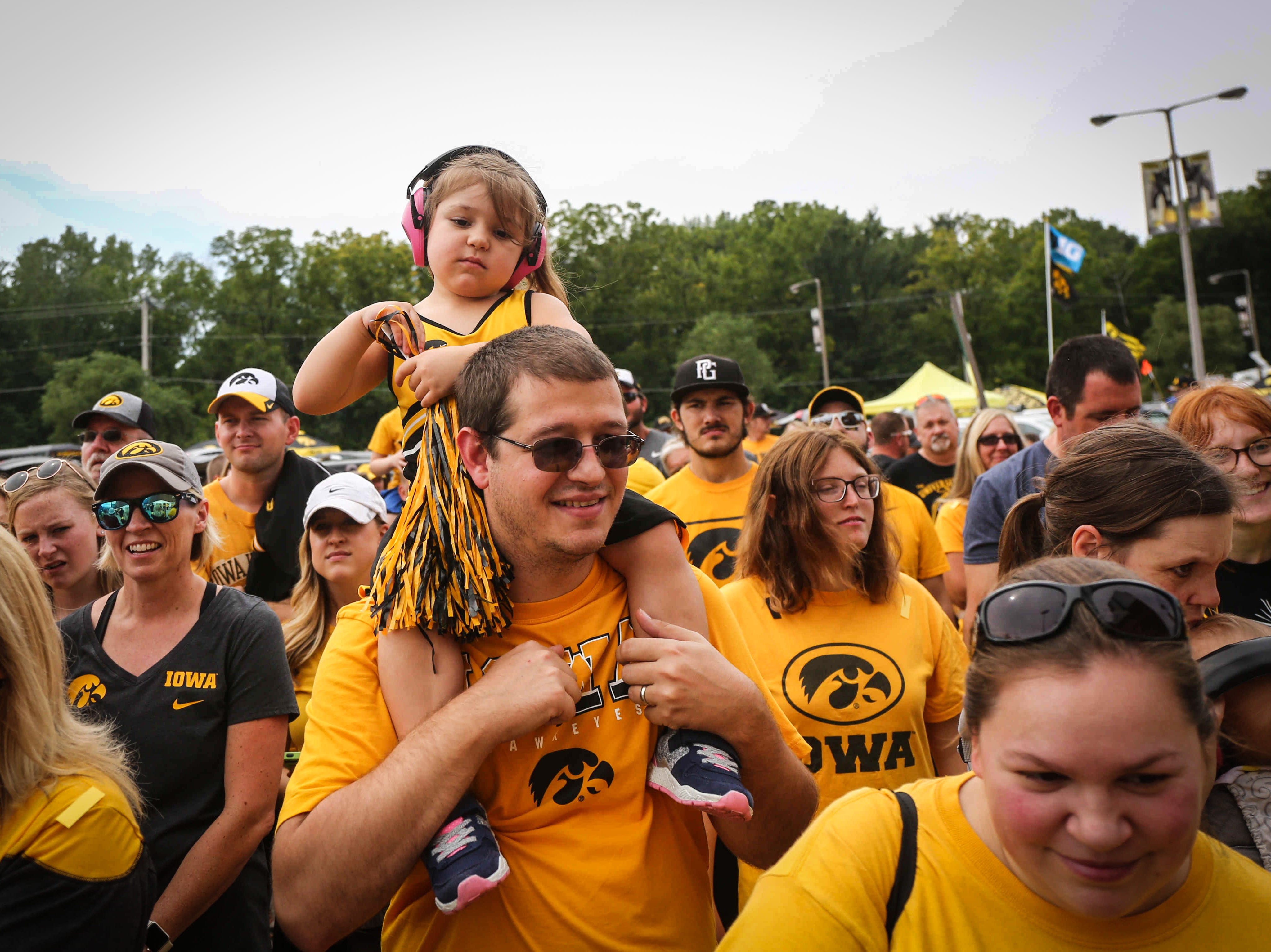 Fans gather to hear the Iowa band prior to kickoff against Northern Illinois on Saturday, Sept. 1, 2018, in Iowa City.