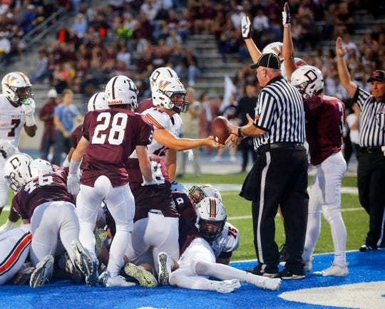 Valley quarterback Beau Lombardi scores a 1 yard touchdown during the Dowling West Des Moines Valley game at Drake stadium Aug. 31, 2018.