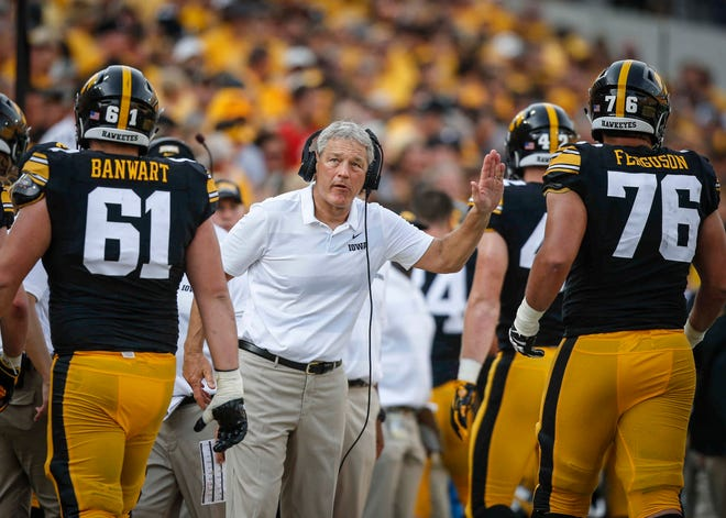 Iowa head football coach Kirk Ferentz celebrates with his team after a Hawkeye score against Northern Illinois on Saturday, Sept. 1, 2018, at Kinnick Stadium in Iowa City.