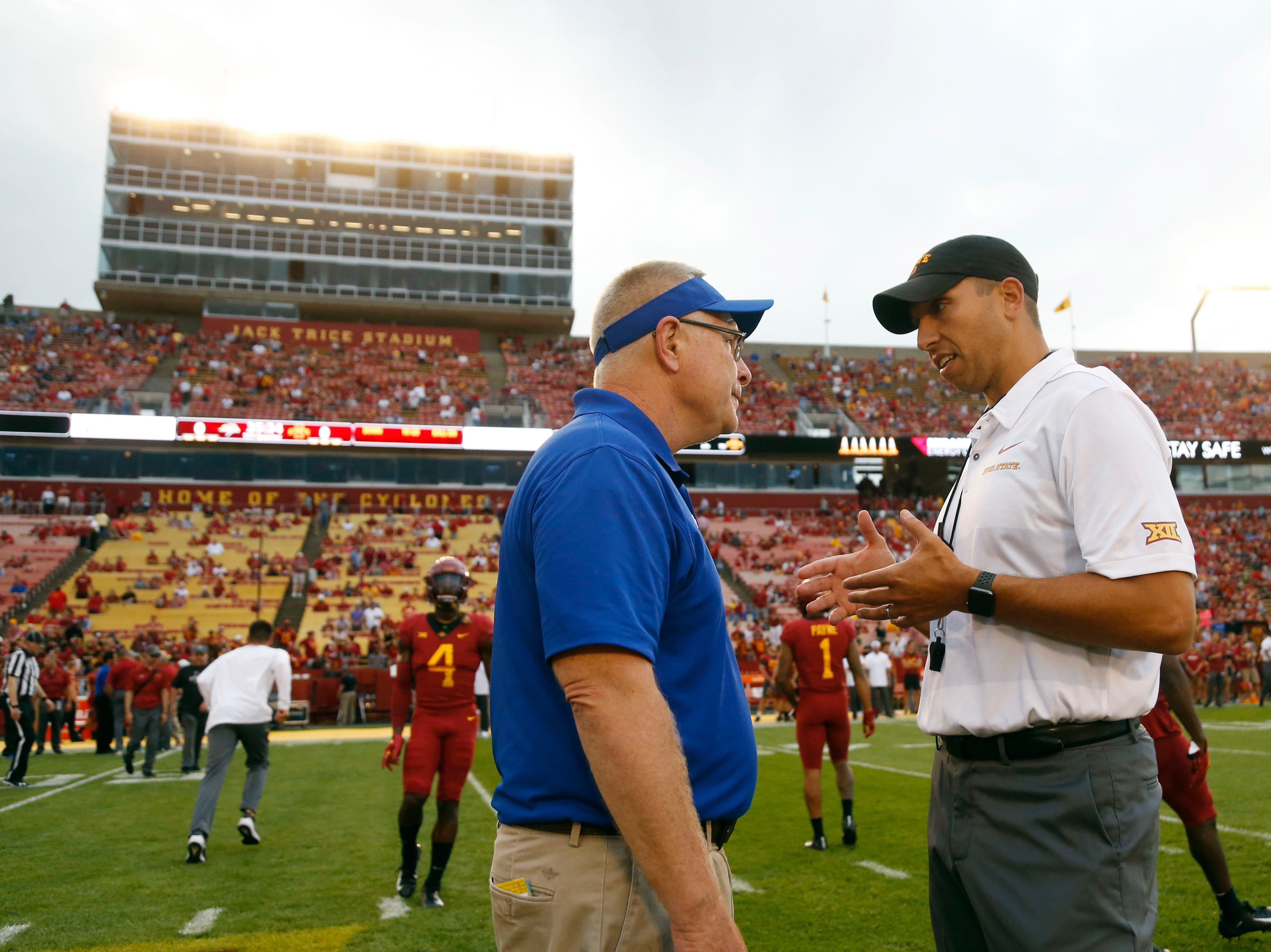 South Dakota State head coach John Stiegelmeier (left) talks with Iowa State head coach Matt Campbell  Saturday, Sept. 1, 2018, before their game at Jack Trice Stadium in Ames.