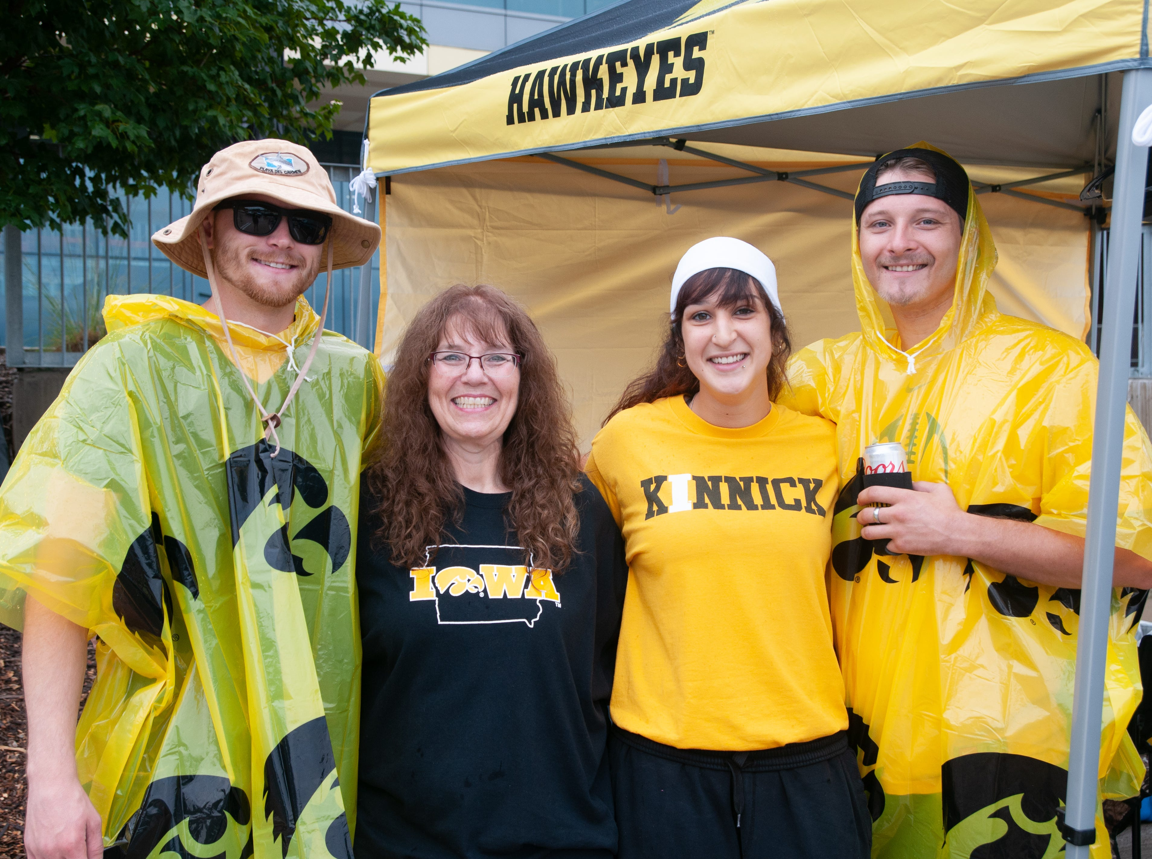 Tyler Pirri, 25, (left), Eddeana Hardy, 52, Cheyanne Schalk, 20, and Spencer Hardy, 25, of Mint Rose, Saturday, Sept. 1, 2018, while tailgating before the Iowa game against Northern Illinois in Iowa City.
