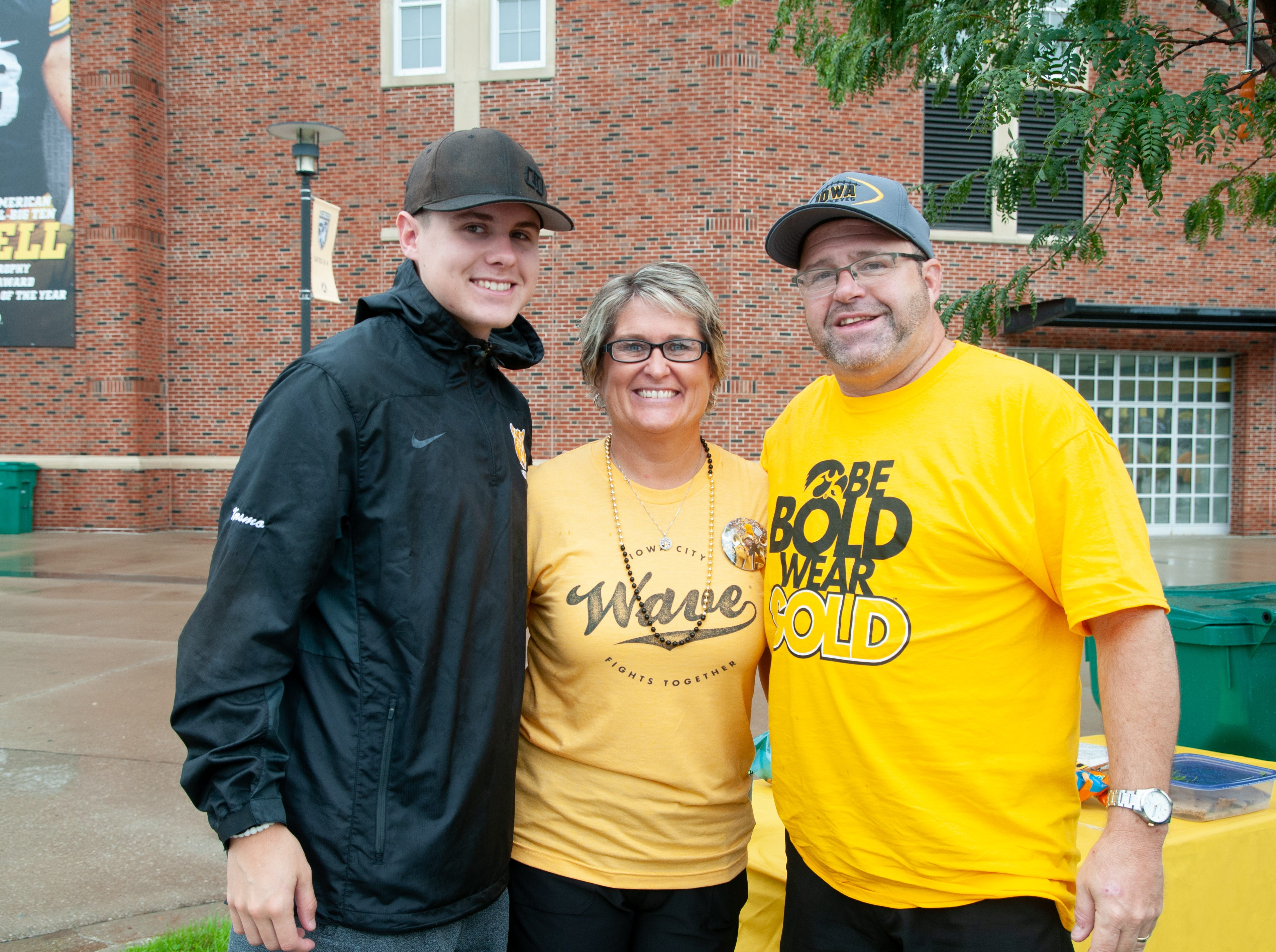 Kacey, 19, (left), Amy, 48, and Kevin Korsmo, 54, of Atkins, Saturday, Sept. 1, 2018, while tailgating before the Iowa game against Northern Illinois in Iowa City.
