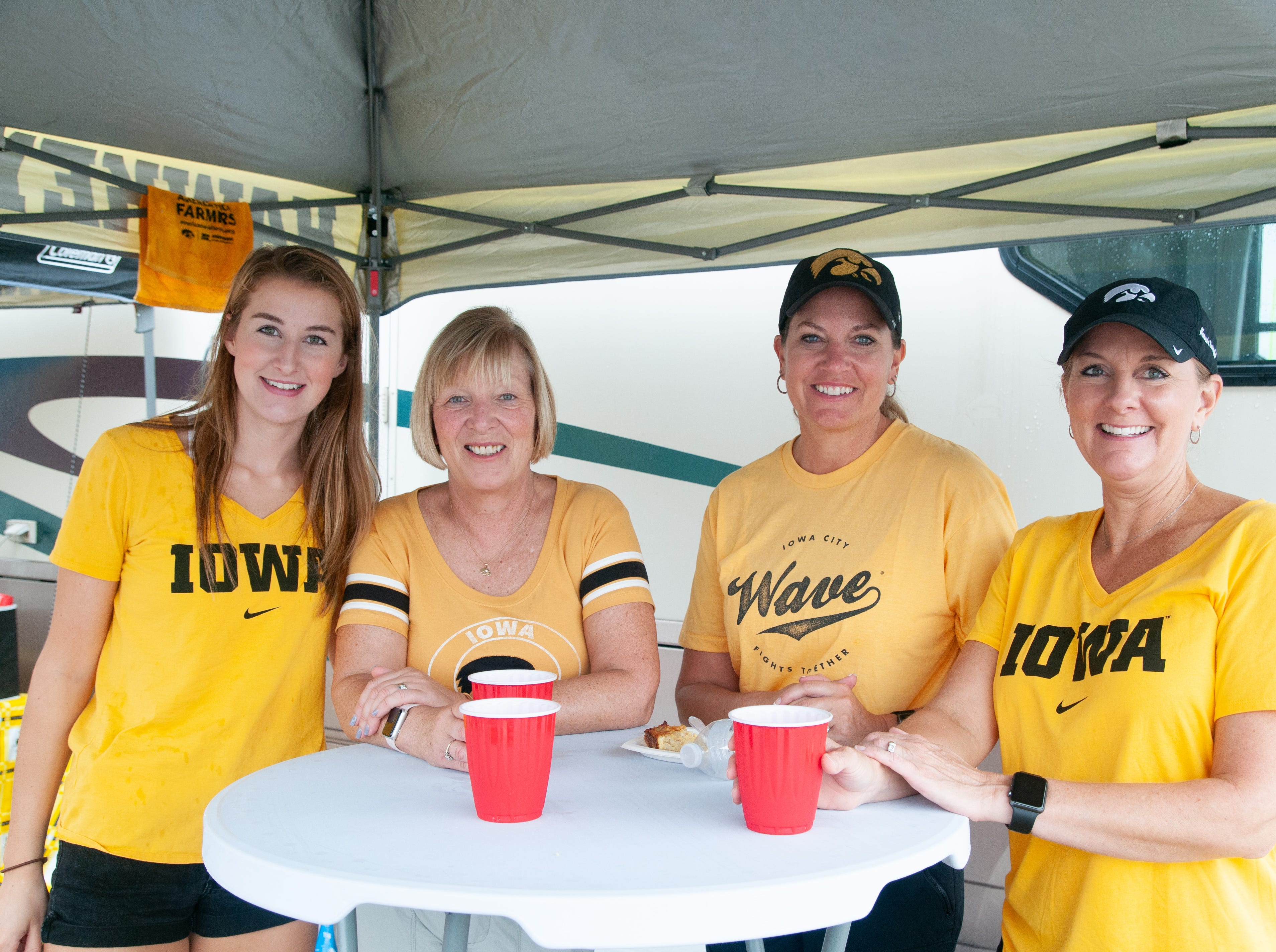 Beth Jamison, 47, (left), Chrissy Westendorf, 47, Linda Bergdale, 56, and Emily Burtch, 18, Saturday, Sept. 1, 2018, while tailgating before the Iowa game against Northern Illinois in Iowa City.