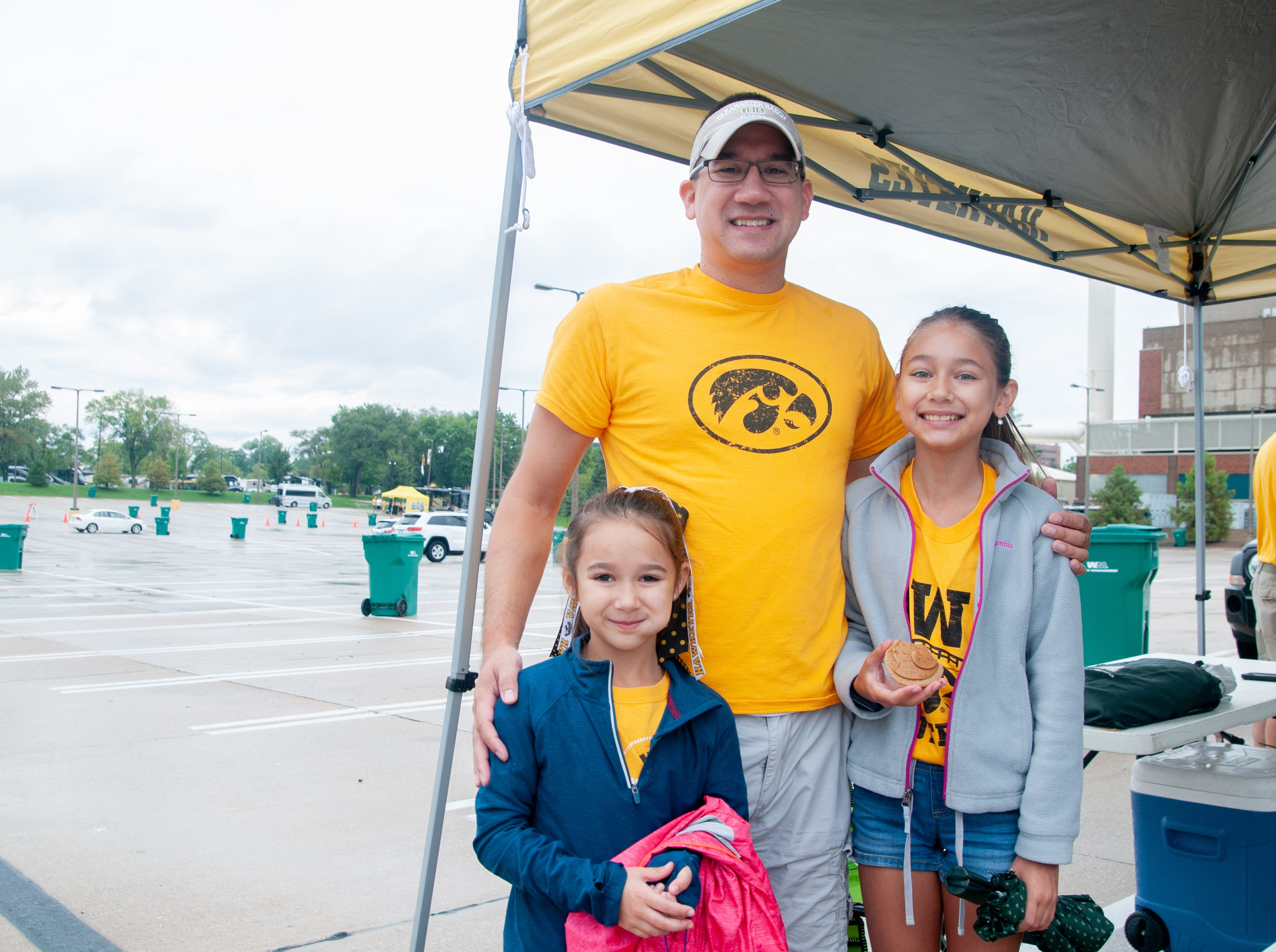 Marina, 6, (left), Jason, 42, and Melia Drugg, 11, of Coralville, Saturday, Sept. 1, 2018, while tailgating before the Iowa game against Northern Illinois in Iowa City.