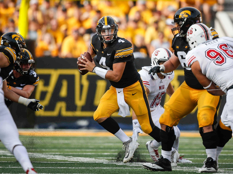 Iowa junior quarterback Nate Stanley scrambles against Northern Illinois on Saturday, Sept. 1, 2018, at Kinnick Stadium in Iowa City.