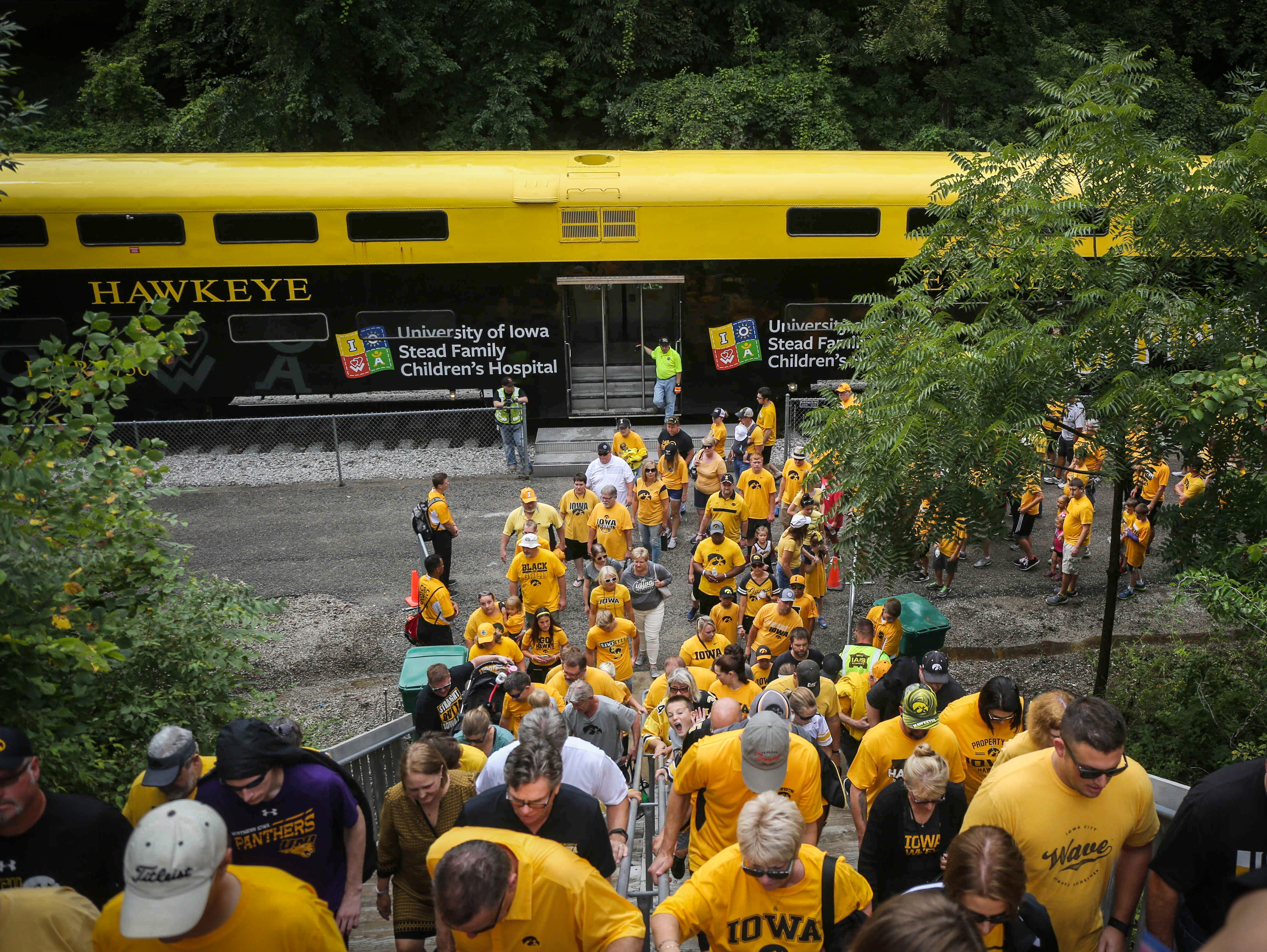 Iowa fans flock up to Kinnick Stadium from the train prior to kickoff against Northern Illinois on Saturday, Sept. 1, 2018, in Iowa City.