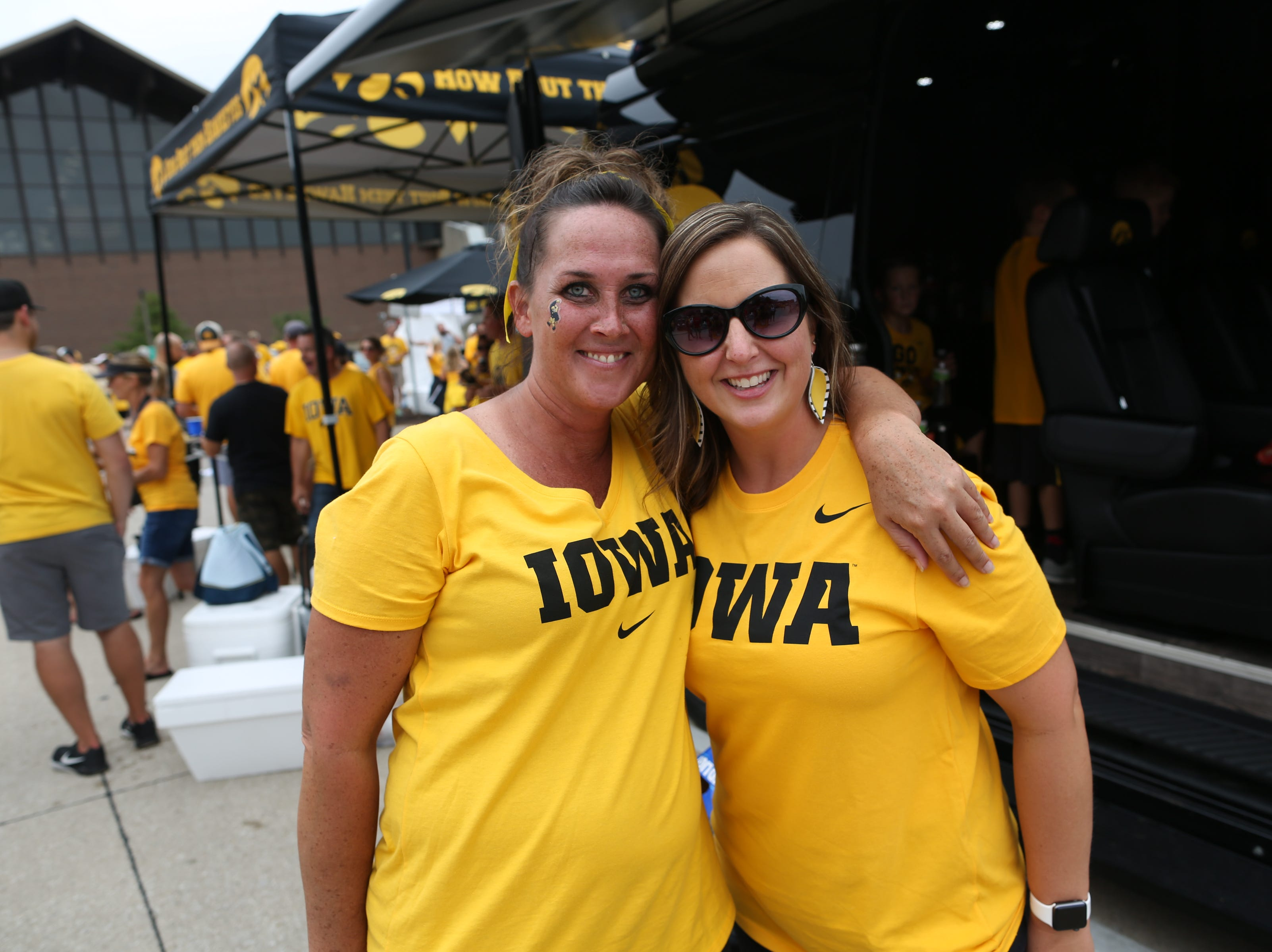 Nikki Steverson, left, of Urbandale and Kinsey Bodensteiner of Clive pose for a photo outside Kinnick Stadium before the Hawkeyes' game against Northern Illinois on Satuday, Sept. 1, 2018.