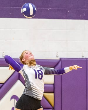 Norwalk's Camryn Gilchrist times her serve against Indianola in a match from Aug. 28, 2018.