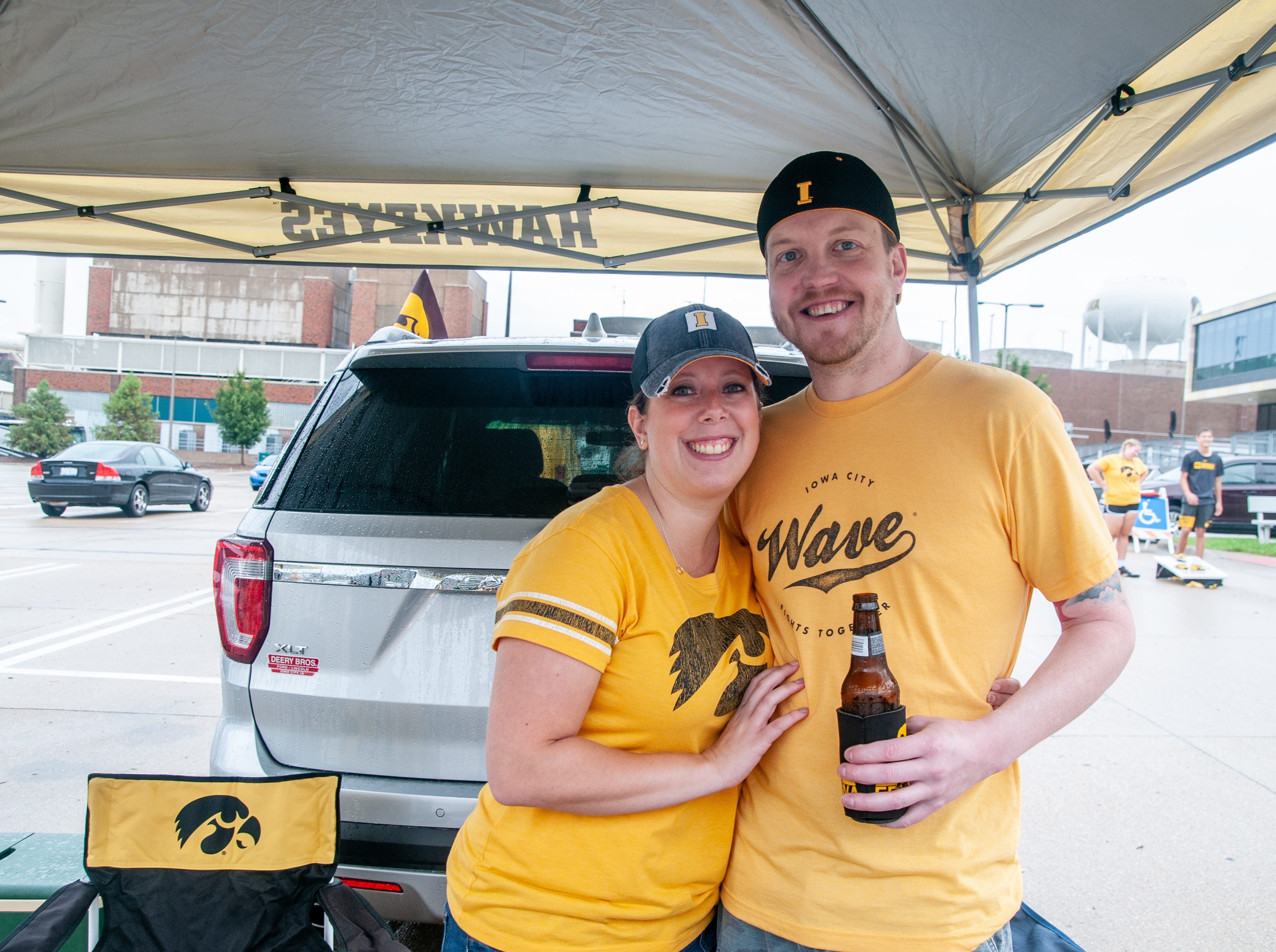 Melissa Johnson, 33, (left), and Ryan Thompson, 36, of Cedar Rapids, Saturday, Sept. 1, 2018, while tailgating before the Iowa game against Northern Illinois in Iowa City.