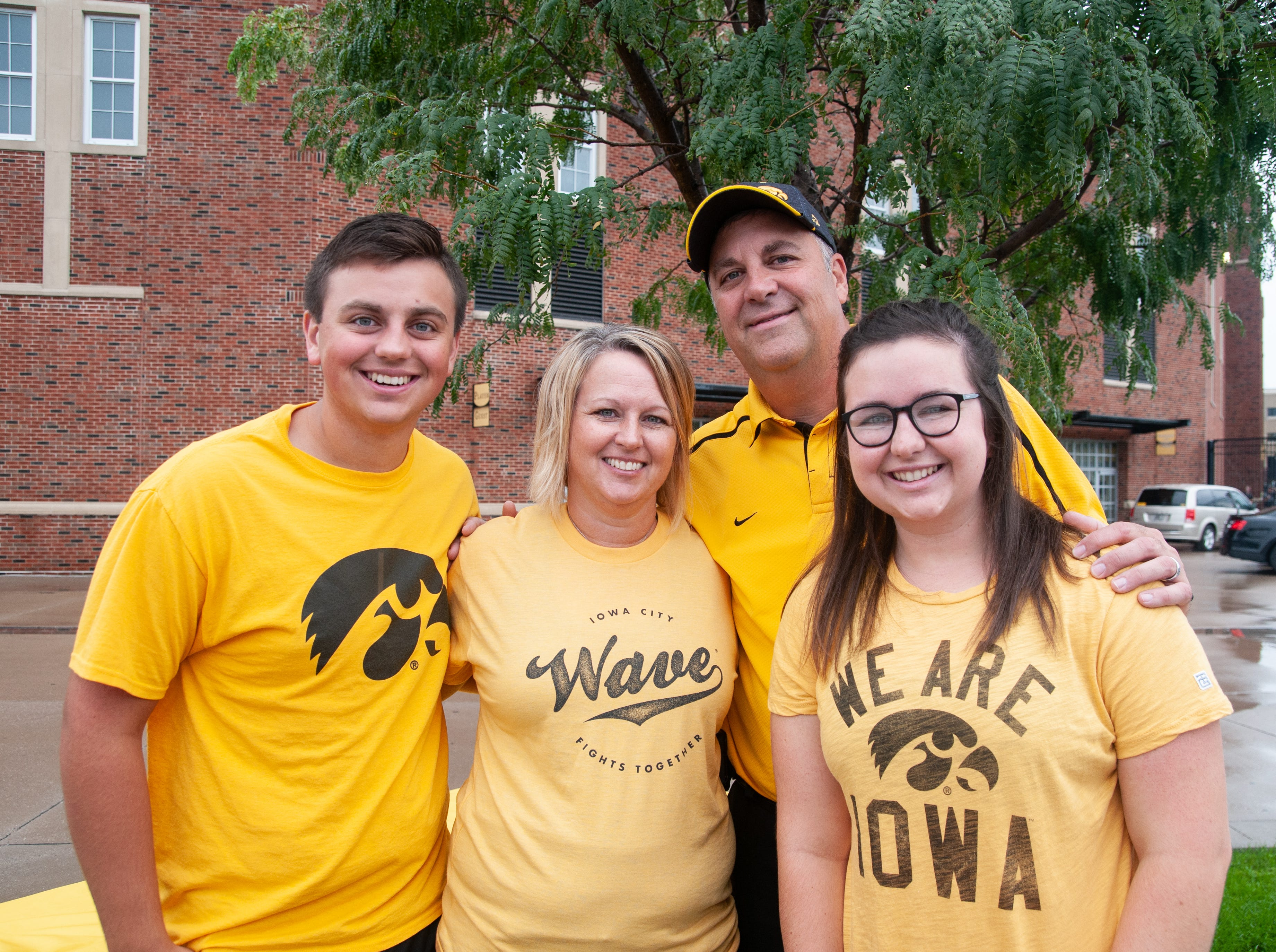 Nate, 18, (left), Cathy, 46, Todd, 47, and Kelsey Ettleman Atkins, 22, Saturday, Sept. 1, 2018, while tailgating before the Iowa game against Northern Illinois in Iowa City.
