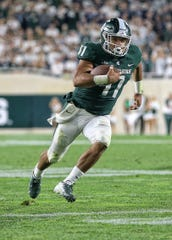Michigan State running back Connor Heyward runs the ball during the second half against Utah State at Spartan Stadium on Aug. 31, 2018.