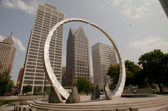 """The metal and stone sculpture is titled """"Transcending"""". It is a Michigan labor legacy landmark located in Hart Plaza near Jefferson in downtown Detroit."""