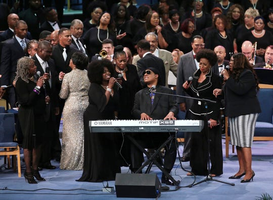 Stevie Wonder is joined by other singers at the end of the funeral for the late Aretha Franklin at Greater Grace Temple in Detroit on Friday, August 31, 2018.
