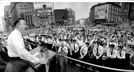 UAW leader Walter Reuther took a few minutes off from negotiating to speak at Cadillac Square, Sept. 4, 1961.