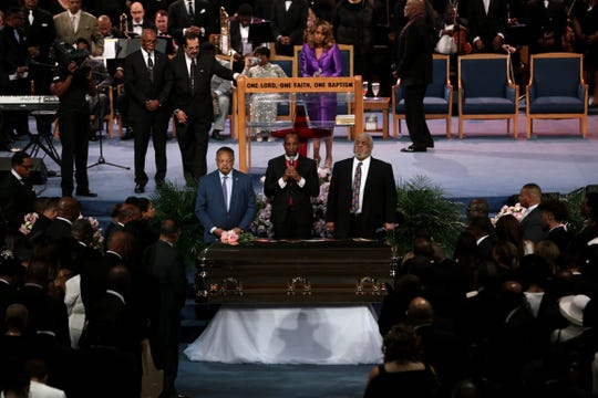 The Rev. Jesse Jackson, Bishop Charles Ellis III and the Rev.  Robert  Smith Jr. stand next to Aretha Franklin's casket  during the funeral  at Greater Grace Temple in Detroit on Friday, August 31, 2018.