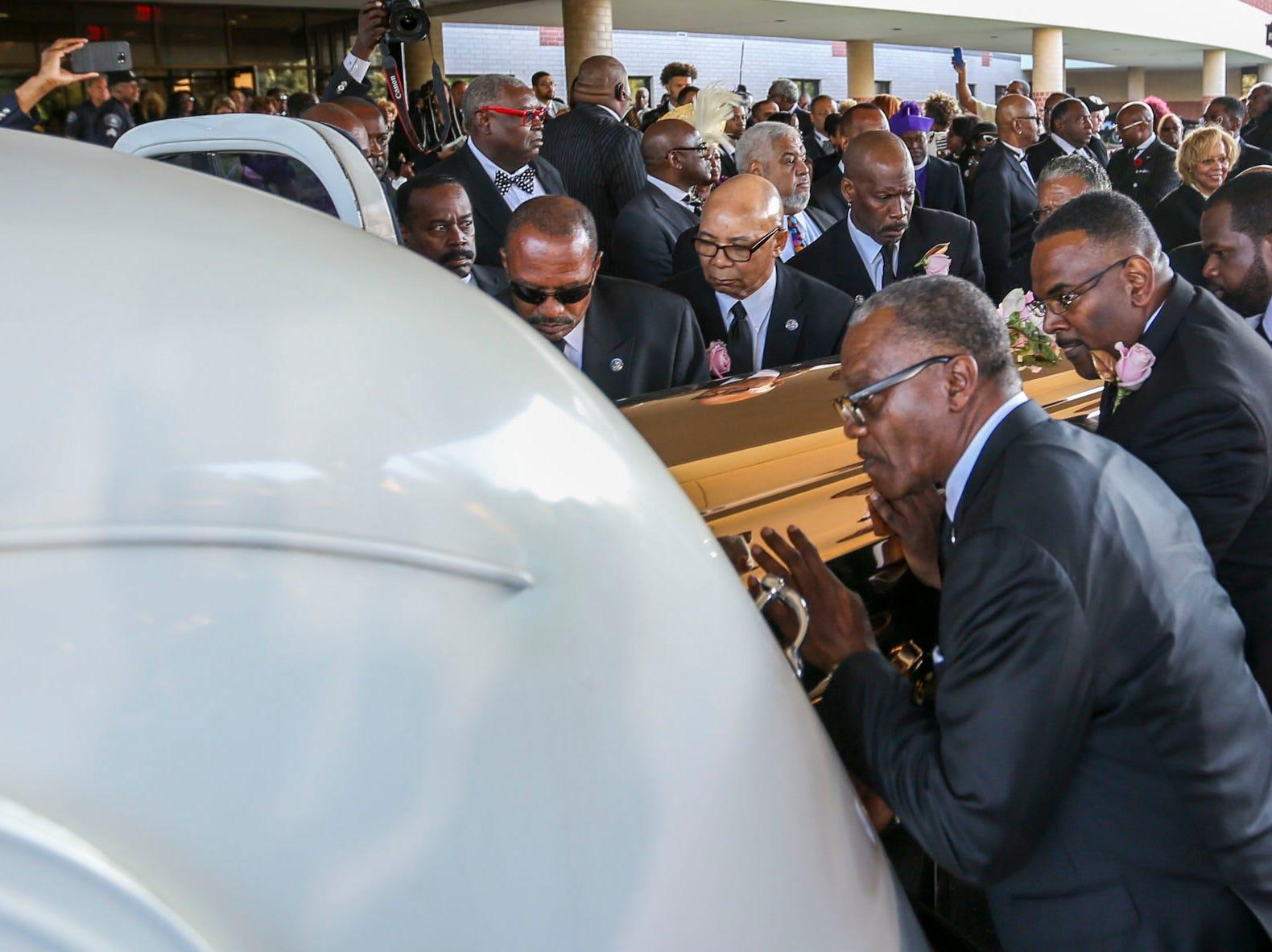 Aretha Franklin's casket is placed in a hearse after her funeral service at Greater Grace Temple in Detroit, on Friday, Aug. 31, 2018.
