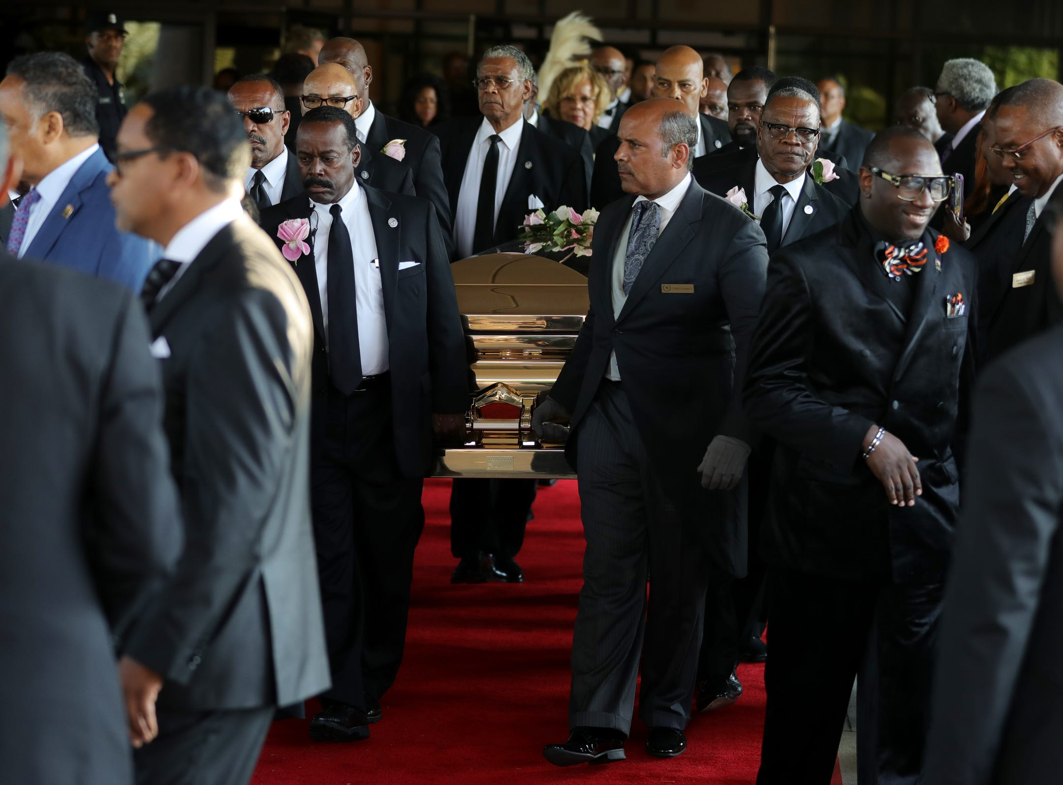 Aretha Franklin's casket is carried to a waiting hearse at Greater Grace Temple following her funeral on Friday, August 31, 2018.