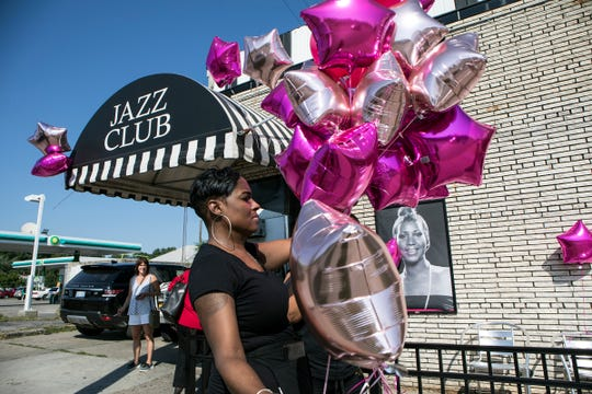 Love Williams, 43 of Detroit finalizes decorations at Baker's Keyboard Lounge in anticipation of Aretha Franklin's funeral to pass by on Livernois Ave. in Detroit, Mich., Friday, August 31, 2018.