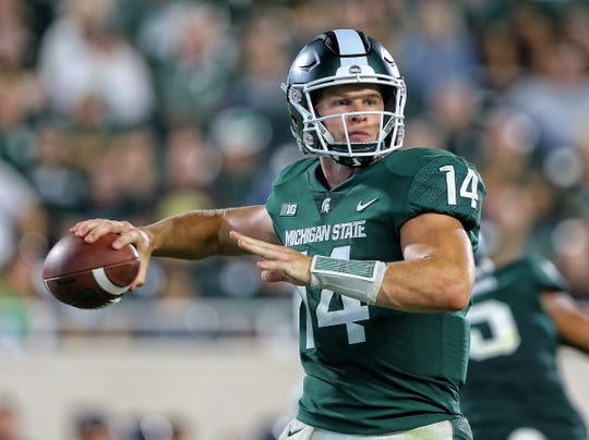 Michigan State quarterback Brian Lewerke looks to pass during the second half against Utah State at Spartan Stadium on Aug. 31, 2018.