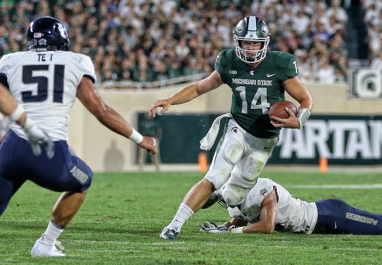 Michigan State quarterback Brian Lewerke runs the ball against Utah State during the first half at Spartan Stadium on Friday, Aug. 31, 2018.