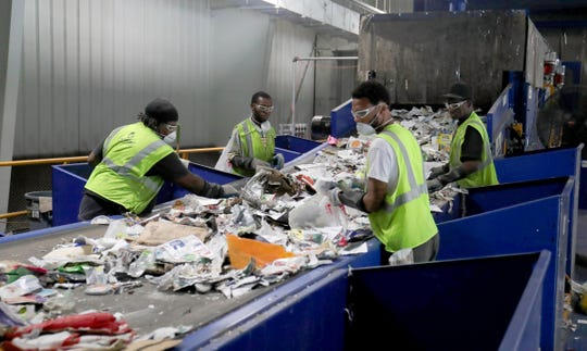 Nigel Lawson, Ziare Williams, Dwayne Williamson and Eddie Thomas work the line picking out material that can't be recycled at the SOCRRA MRF facility in Troy on Thursday, August 30, 2018.
