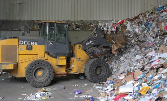 Pete Casaina, a front loader driver at the SOCRRA MRF facility in Troy, digs into the material pile on Thursday, August 30, 2018.