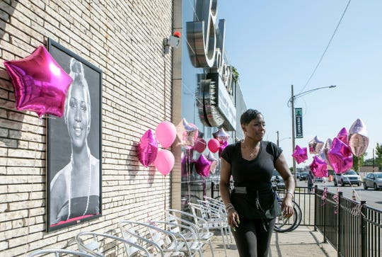 Love Williams, 43, of Detroit finalizes decorations at Baker's Keyboard Lounge in anticipation of Aretha Franklin's funeral to pass by on Livernois Avenue in Detroit.