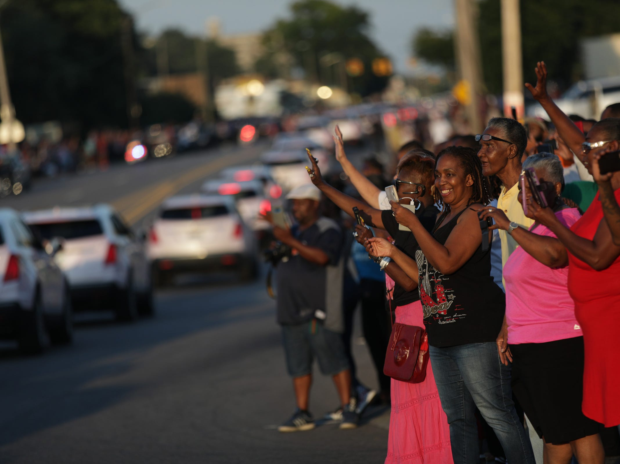 People line up Seven Mile Road to salute Aretha Franklin leaving Greater Grace Temple to the cemetery on Friday, August 31, 2018.
