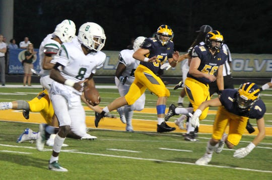 West Bloomfield safety Makari Paige returns an interception against Clarkston. The junior has a 4-star rating and has received over a dozen scholarship offers.