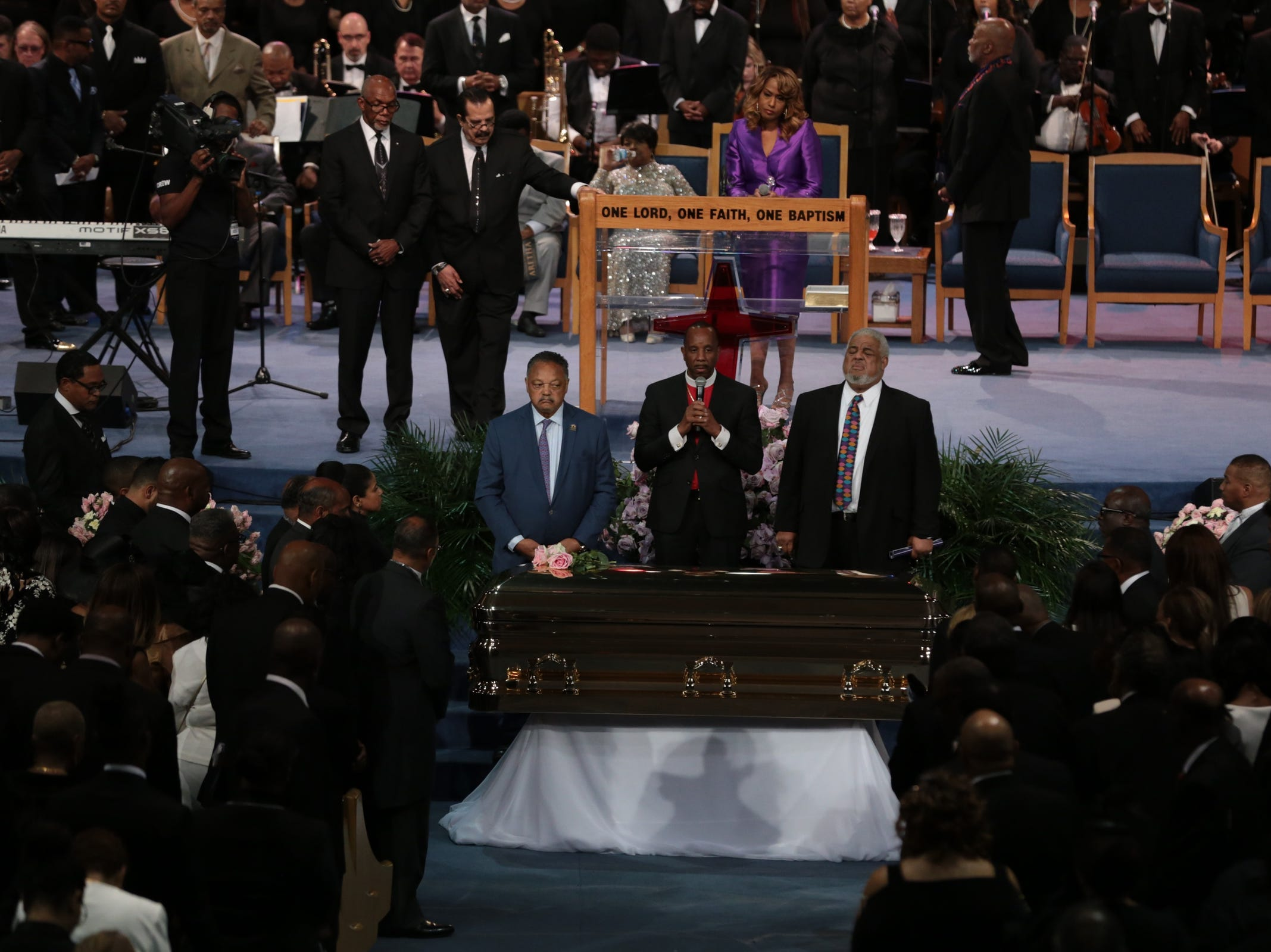 Rev. Jesse Jackson, Bishop Charles Ellis III and Rev.  Robert  Smith Jr. stand next to the casket for Aretha Franklin during the funeral for the late Aretha Franklin at Greater Grace Temple in Detroit on Friday, August 31, 2018.