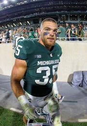 Michigan State's Joe Bachie walks of the field after the 38-31 win over Utah State at Spartan Stadium on Aug. 31, 2018.