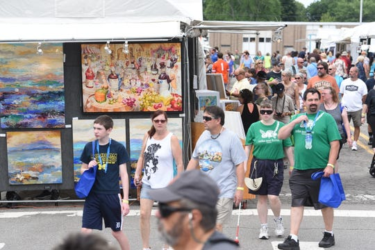 Hundreds of people attend Arts, Beats, and Eats.