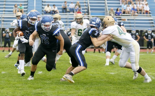 Maurice Rankins Jr. of Horseheads follows the blocking of Maxwell Rohl (75) and Gavin Elston (7) during the Blue Raiders' 13-6 win over Vestal on Sept. 1, 2018 at Horseheads High School.