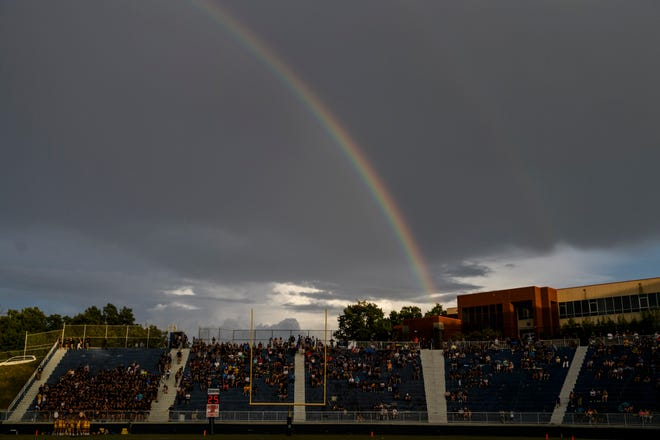 A rainbow appears before the rivalry match-up between the Castle Knights and the Reitz Panthers at the Reitz Bowl in Evansville, Ind., Friday, Aug. 31, 2018. The Panthers secured the football program's 700th win by defeating the Knights 38-21.