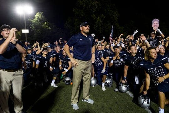 Reitz coach Andy Hape addresses his team last year after a victory against Castle. The Panthers faced West Side rival Mater Dei in a scrimmage on Friday.