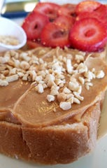 """World's Greatest PB&J"" at G.D. Ritzy's: thick sliced bread, peanut butter with fresh peanuts, strawberry jam and sliced fresh strawberries."