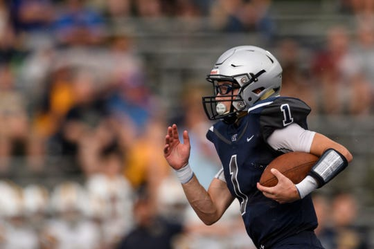 Reitz quarterback Eli Wiethop (1) races downfield in the first quarter of the Panthers' 38-21 victory over visiting Castle.