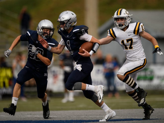 Reitz's Quarterback Eli Wiethop (1) races down the field as Castle's Hunter Cline (17) and Reitz's Colin Long (22) attempt to keep up with him during the first quarter at the Reitz Bowl in Evansville, Ind., Friday, Aug. 31, 2018
