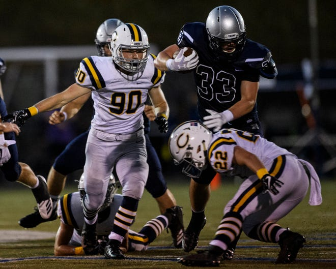 Reitz's Carter Schnarr (33) weaves around Castle's Cooper Forshee (22) at the Reitz Bowl in Evansville, Ind., Friday, Aug. 31, 2018. The Panthers secured the football program's 700th win by defeating the Knights 38-21.