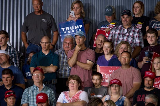 President Donald Trump supporters attend his campaign rally at the Ford Center in Evansville, Ind., Thursday night.