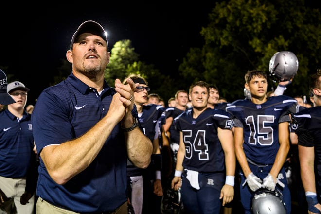 Reitz coach Andy Hape listens to a poem being read over the public address system after the Panthers posted their historic 700th win last year at Castle's expense, 38-21, on Aug. 31.