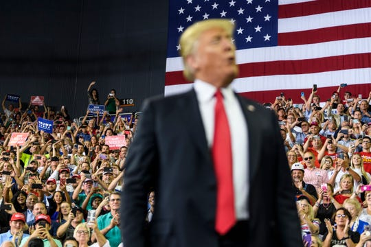 The crowd erupts in cheer as President Donald Trump takes the stage during a Make America Great Again rally at the Ford Center in Evansville, Ind., Thursday, Aug. 30, 2018.