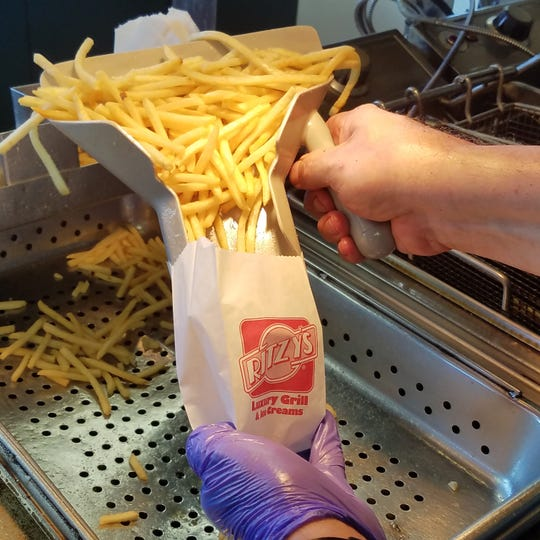A pile of hot, fresh shoestring fries makes a great compliment to a crisp-edged griddled burger.