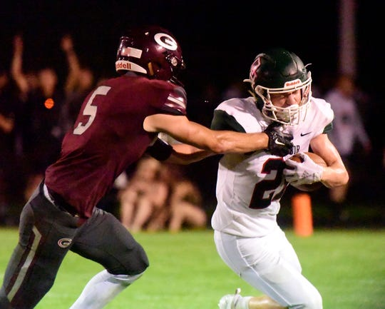 Genoa's Jacob Plantz had 11 solo tackles against Oak Harbor and intercepted two passes, including one returned for a touchdown.