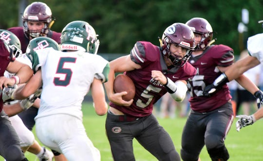 Genoa's Jacob Plantz rushed for one touchdown and threw another to Nate Lewis against Oak Harbor.