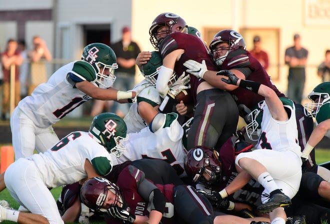 Genoa's Jacob Plantz rushes for a touchdown against Oak Harbor.