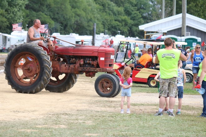 Thousands gathered for the the 30th annual S.C.R.A.P. Antique Tractor and Engine Show at White Star Park in Gibsonburg on Saturday.